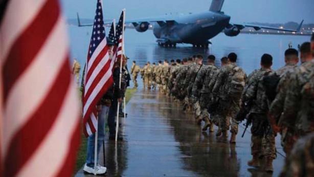 Foto - 82. Havada Tümeni'nde bulunan ABD askerlerinin bu olağandışı dönüşü, 10 saatten fazla süren uçuşun ardından Kuzey Carolina'daki (genel merkezi) Fort Bragg askeri üssünde çiçek ve hediye almak yerine koronavirüs (Kovid-19) için muayene ve test ekipmanı ile karşılandı. ABD askerleri 14 gün karantinada kalacak.