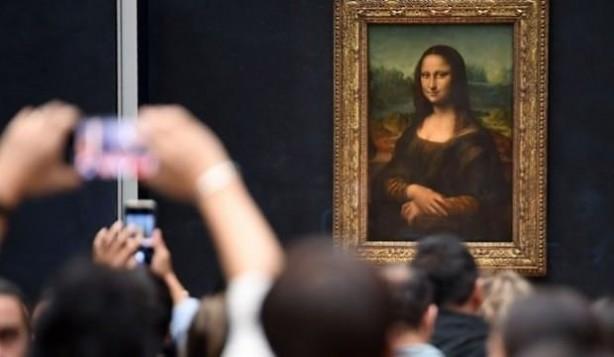 Foto - Tabloların taşınması ve devredilmesi kolay ve bizim de bir sürü tablomuz var. Ayrıca, Louvre'un kaç ziyaretçisi ve kaç Mona Lisa hayranı, aynı salonda bulunan Paolo Veronese imzalı 67 metrekarelik ve 130 karakterlik Kana'da Düğün (The Wedding at Cana) tablosunu dikkatle incelemek için zamanını ayırıyor ki?