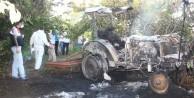 Devrilen traktörde yanarak can verdi