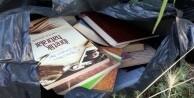 Gülen'in kitap ve CD'lerini boş araziye attılar