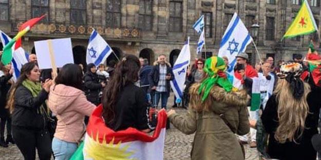 Avrupa'nın göbeğinde rezalet! Terör paçavraları katil İsrail bayraklarıyla bütünleşti