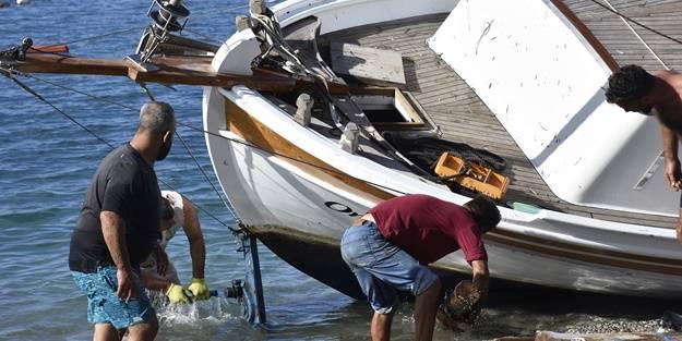 Bodrum'da kuvvetli rüzgar! Bir tekne karaya oturdu