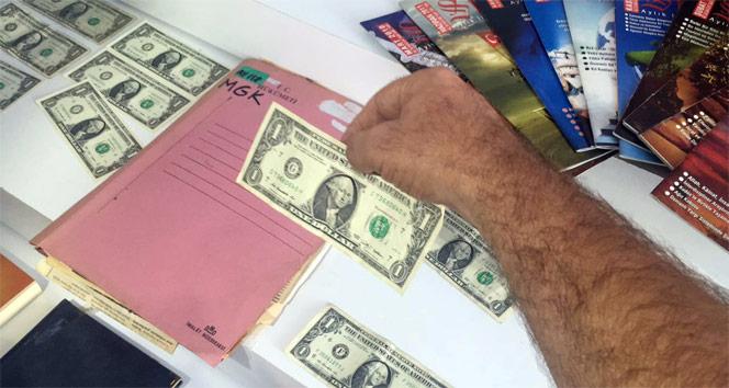 Ele geçirilen okunmuş ve şifrelenmiş 1 dolarlar