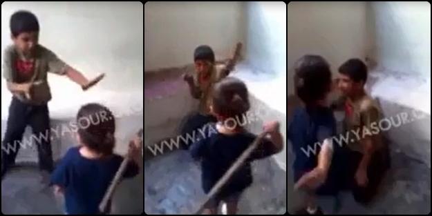 Filistinli çocuğu yakalayıp kızlarına dövdürdüler! (VİDEO)