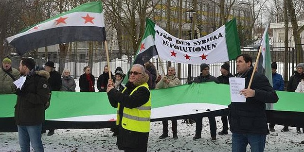 İsveç'te Putin ve Esed protesto edildi
