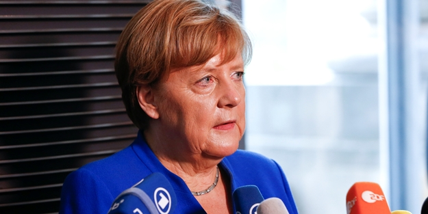 Erdoğan'ın sözleri sonrası Merkel'den geri adım! Dikkat çeken Türkiye açıklaması