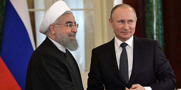 Putin ve Ruhani'den otobüste zirve selfie'si