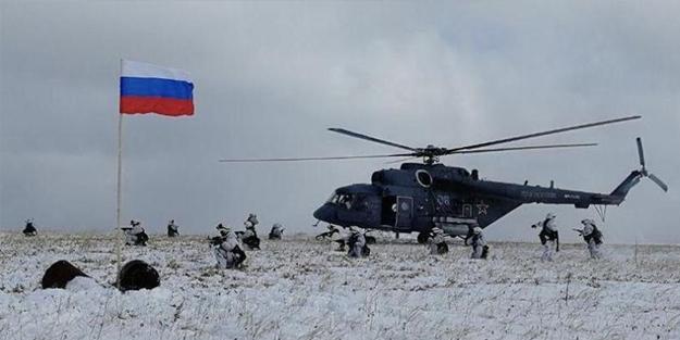 Rusya'dan Asya ülkesine gözdağı! Askerler sınırda