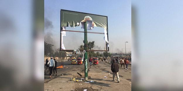 Ülkede kazan kaynıyor! Göstericiler Kasım Süleymani'nin afişini ateşe verdi