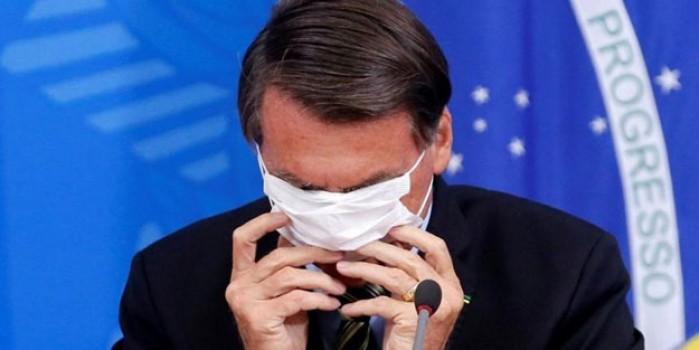 Koronavirüse yakalanan Bolsonaro'dan maske şovu